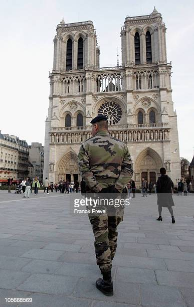 A soldier stands in guard in front of Notre Dame Cathedral on October 18 2010 in Paris France France has been warned by Saudi Arabia that it is a...