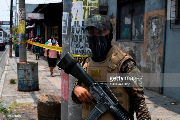 Soldier stands next to a sanitary perimeter imposed by San Salvador's municipality to prevent the spread of the new coronavirus COVID-19, in the...