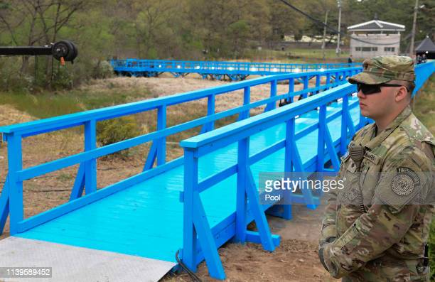 Soldier stands next to the blue bridge ahead of a ceremony to mark the first anniversary of Panmunjom declaration between South Korean President Moon...
