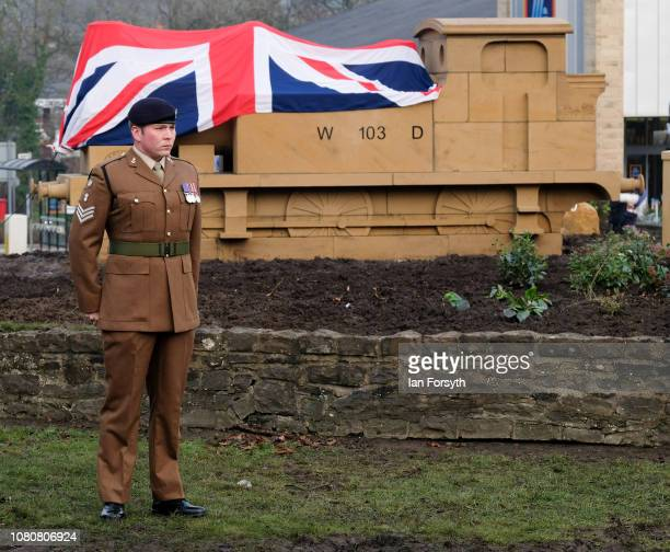 A soldier stands next to the Union Flag draped centre piece in Catterick Garrsion ahead of its unveiling by former Royal Engineer and Dunkirk veteran...