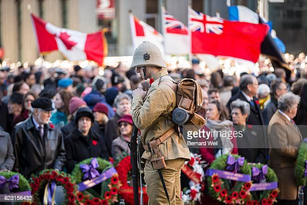 TORONTO ON NOVEMBER 11 A soldier stands on guard as hundreds gathered at the Old City Hall Cenotaph on Friday morning to commemorate Remembrance Day...