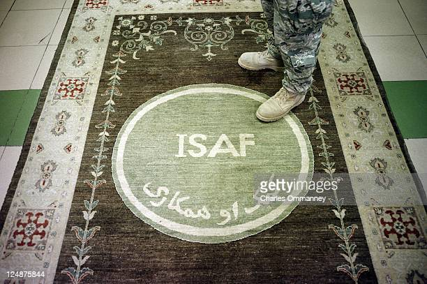 Soldier stands on the Afghan carpet outside of General John Allen's office at ISAF on July 19, 2011 in Kabul, Afghanistan.