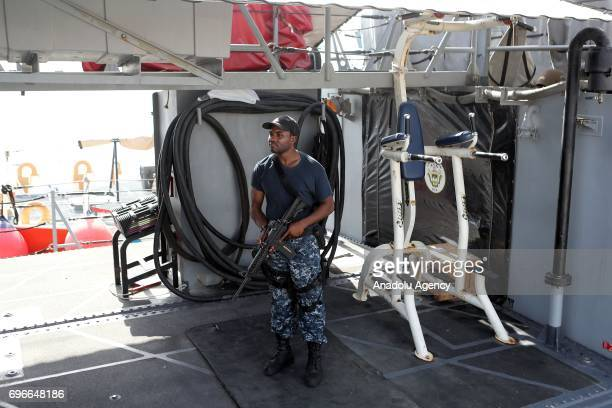 A soldier stands on the deck of USS Chinook of US navy at Hamad Port in Doha Qatar on June 16 2017 After 12 billion dollars worth F35 fighter jet...