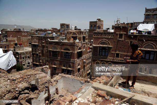 Soldier stands on the roof of a historic building after it was collapsed partially due to the heavy rains in the UNESCO World Heritage-listed Old...