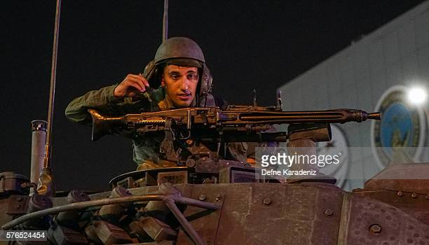A soldier stands on top of Turkish army's tank as they enter the Ataturk Airport on July 16 2016 in Istanbul Turkey Istanbul's bridges across the...