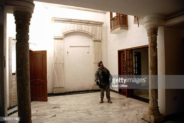Soldier stares at the high ceiling of one of the larger abandoned estates in his area. Almost everything in the house was marble.