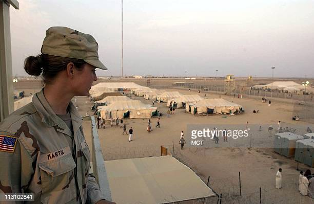 A US soldier stationed at Camp Bucca the USrun detention center 300 miles south of Baghdad watches detainees from a guard's post The US military is...