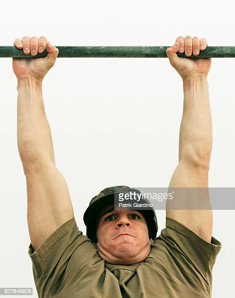 soldier struggling through chin-ups - struggle stock pictures, royalty-free photos & images