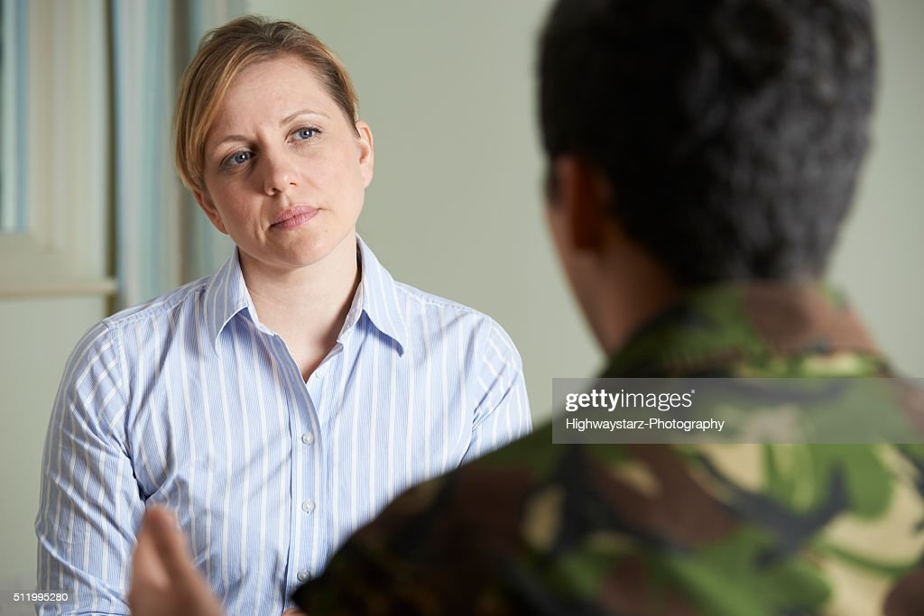 Soldier Suffering With Stress Talking To Counselor : Stock Photo
