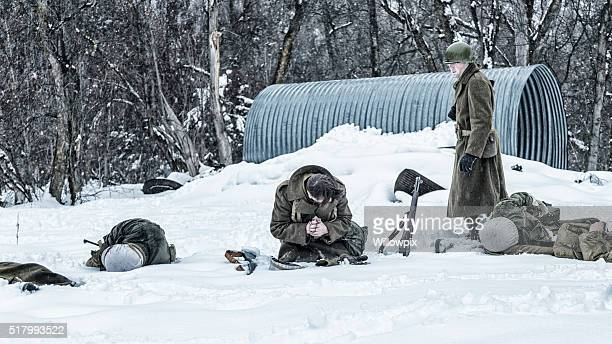 wwii soldier survivors with dead ambushed war casualties - soldier praying stock pictures, royalty-free photos & images