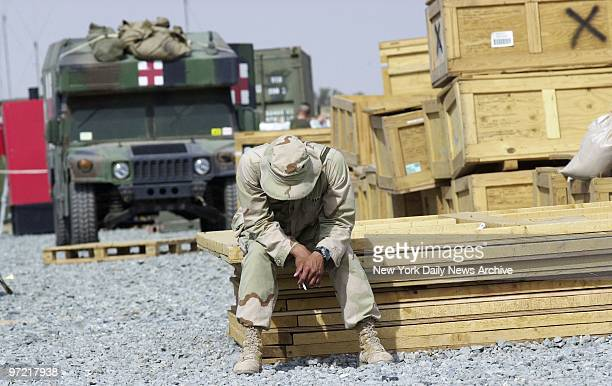 A soldier takes a break at Al Jaber Air Base in Kuwait New York City firefighters sanitation and transit workers all Navy Seabees called up for a...