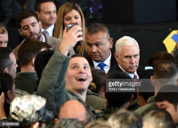 A US soldier takes a selfie with US Vice President Mike Pence after he addressed US soldiers at Yokota Air Base at Fussa near Tokyo on February 8...