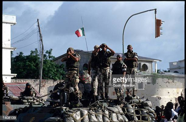 A soldier takes aim July 9 1993 in Mogadishu Somalia Following heavy attack by Somali rebel forces Italian troops retake the Pasta checkpoint as part...
