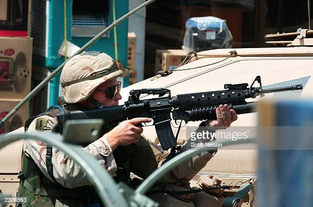 S soldier takes cover during a gunbattle with unknown gunmen that followed a rocket propelled grenade attack on US troops August 7 2003 in dowtown...