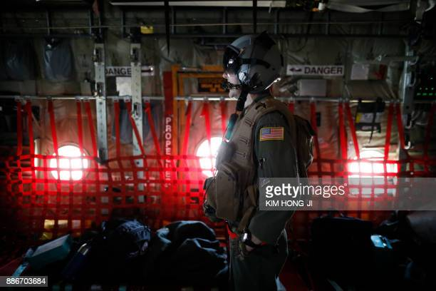 A US soldier takes part in a joint aerial drills called 'Vigilant Ace' between the US and South Korea at the Osan Air Base in Pyeongtaek on December...