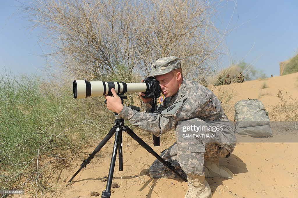 A US Soldier Takes Pictures With Telephoto Lens During The Joint India Yudh