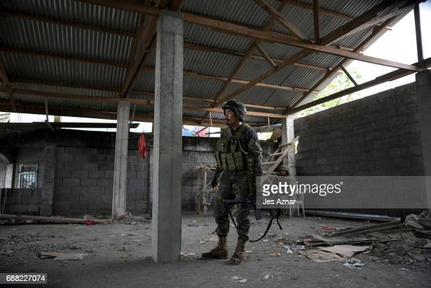 A soldier taking a look at enemy positions while they try to clear the city of armed militants one street at a time on May 25 2017 in Marawi city...