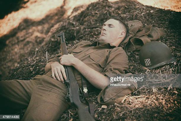 ww2 soldier taking a nap on mulch - army stock pictures, royalty-free photos & images
