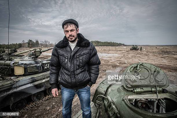 Soldier that just back for rotation from Debaltseve in Donetsk region helps his colleagues during training of armed vehicles firing at the 169th...