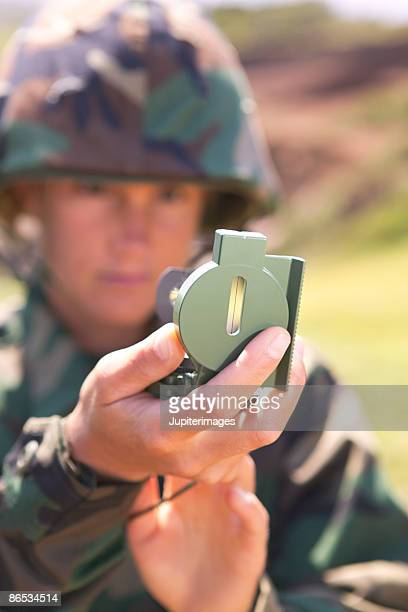 Soldier using compass scope