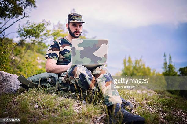 soldier using computer - technology trade war stock pictures, royalty-free photos & images
