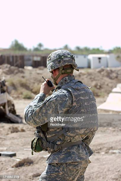 Soldier using radio to communicate