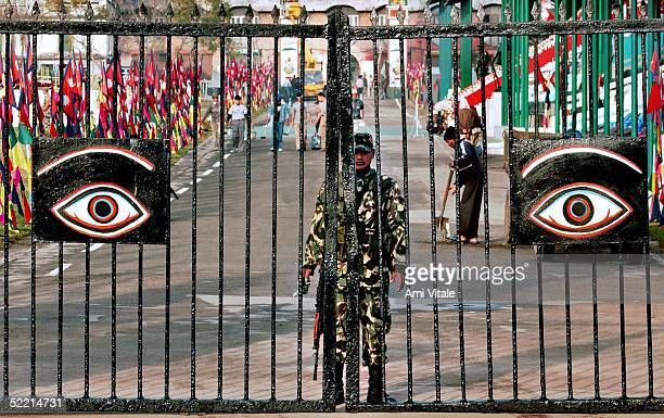Soldier waits for the arrival of King Gyanendra and Queen Komal as thousands during of celebration Democracy Day and the Queen's 55th birthday...