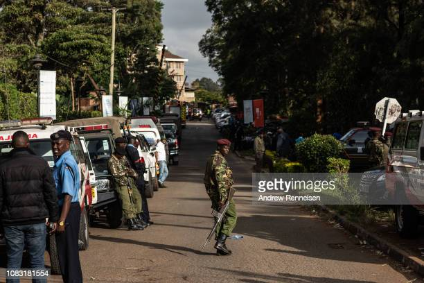 A soldier walks across the road leading to the Dusit Hotel on January 16 2018 in Nairobi Kenya A security operation continued into a second day after...