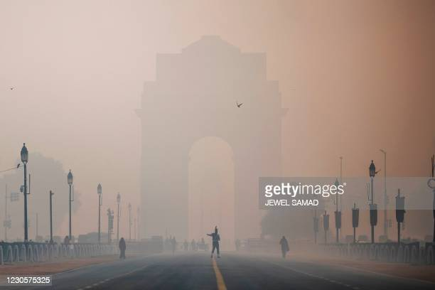 Soldier walks along a street near India Gate amid smoggy conditions in New Delhi on January 14, 2021.