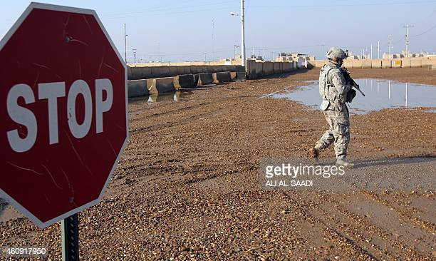 US soldier walks at the Taji base complex which hosts Iraqi and US troops and is located thirty kilometres north of the capital Baghdad on December...