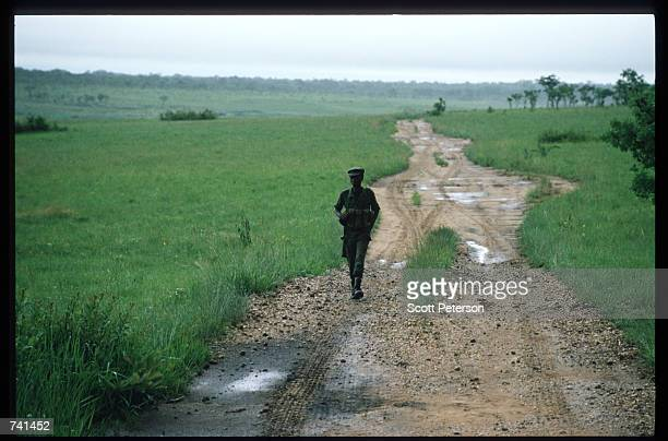 UNITA soldier walks down a dirt road January 23 1990 near Jamba Angola The National Union for the Total Independence of Angola and the Marxist forces...