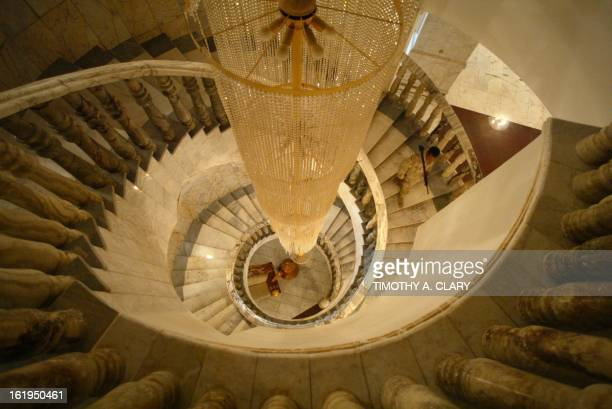 A US soldier walks down a main stairwell inside the Radwaniyah Palace used during the toppled regime of Iraqi leader Saddam Hussein as a reception...