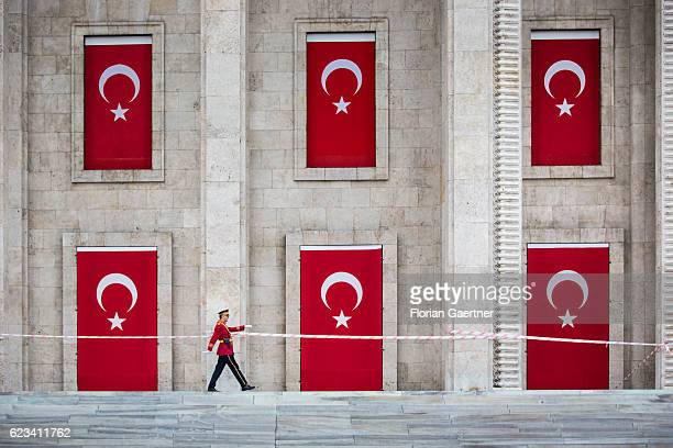 A soldier walks in front of the damaged building of the turkish Parliament on November 15 2016 in Ankara Turkey