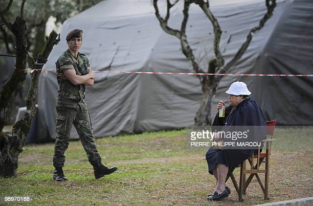 A soldier walks next to a pilgrim near Fatima's Sanctuary on May 11 2010 Pope Benedict XVI landed in Lisbon to begin a fourday visit included Fatima...