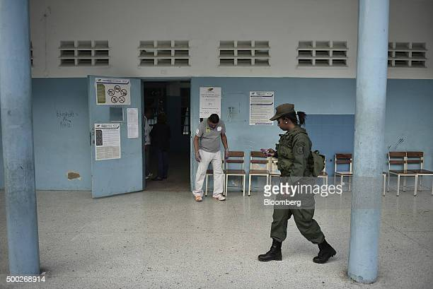 A soldier walks past a polling station in the Coche area during the national congressional elections in Caracas Venezuela on Sunday Dec 6 2015...
