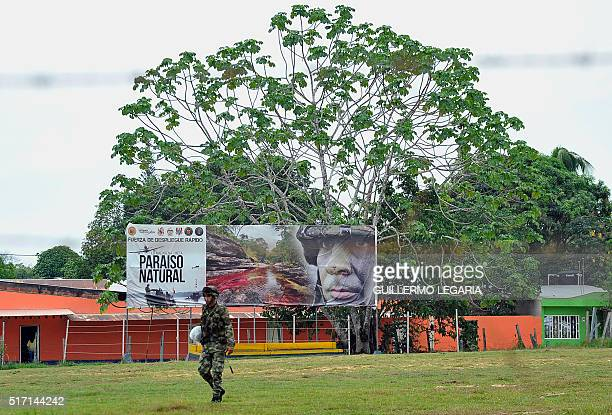 A soldier walks past a poster in La Macerena Meta department Colombia on February 24 2016 Between 1998 and 2002 during the failed peace talks with...
