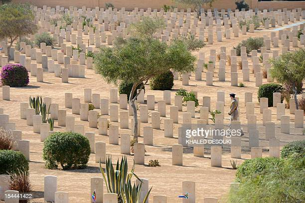A soldier walks past the graves of fallen World War II soldiers on October 20 during an international commemoration organized by Britain to mark 70...