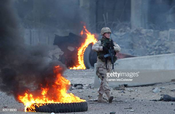 S soldier walks through debris left by a massive car bomb that exploded near the Australian Embassy January 19 2005 in the al Karrada neighborhood of...