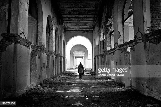 A soldier walks through the ruins of the Royal Palace in Kabul which has been destroyed after many years of fighting in civil war against the Soviet...