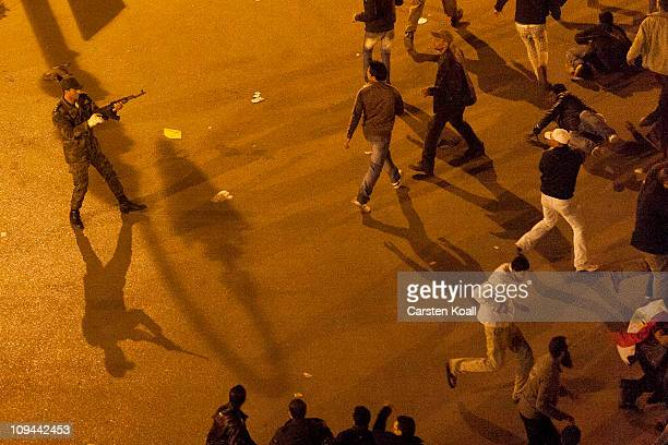 A soldier warns protesters near Tahrir Square Feburary 26 2011 in Cairo Egypt Soldiers fired in the air and used batons on protesters who were...