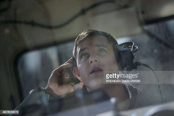 A soldier watches from a control booth as he deploys an aerostat from its mobile mooring station February 4 2015 at the Aberdeen Proving Ground in...