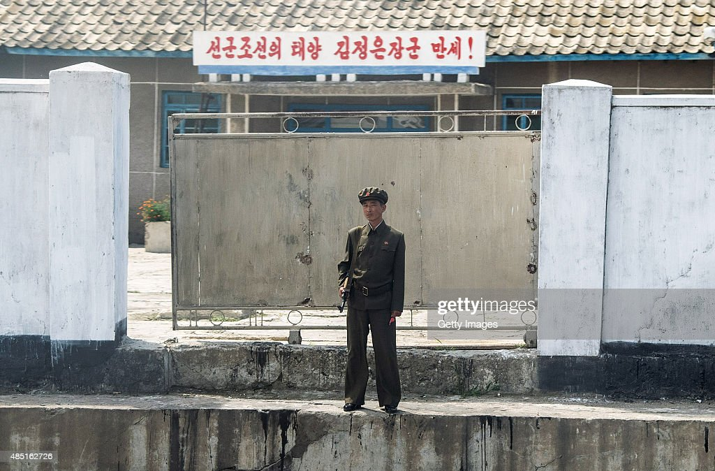 A soldier watches the train at a small railway station on August 24, 2015 in Pyongyang, North Korea. North and South Korea today came to an agreement to ease tensions following an exchange of artillery fire at the demilitarized border last week.