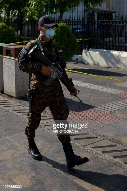 A soldier wearing a face mask patrols the streets of down town after an Exception Regime was put into place San Salvador on March 19 2020 in San...