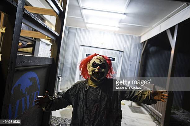 A US soldier wearing a scary clown mask takes part in a Halloween party at the US military camp Bondsteel near the town of Ferizaj on October 30 2015...