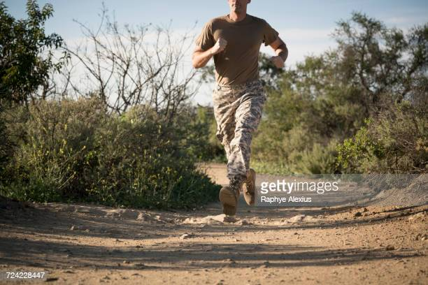 soldier wearing combat clothing running, runyon canyon, los angeles, california, usa - army stock pictures, royalty-free photos & images