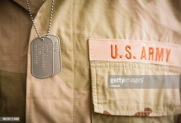soldier wearing shirt and dog tags - military dog tags stock pictures, royalty-free photos & images