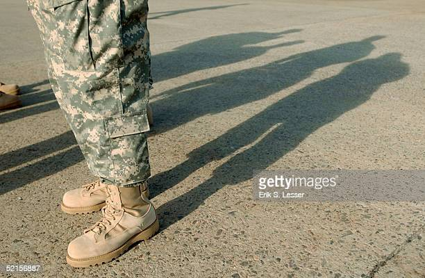 Soldier wears new combat boots, included in the U.S. Army's new Army Combat Uniform , February 8, 2005 at Fort Stewart, Georgia. The ACU includes a...