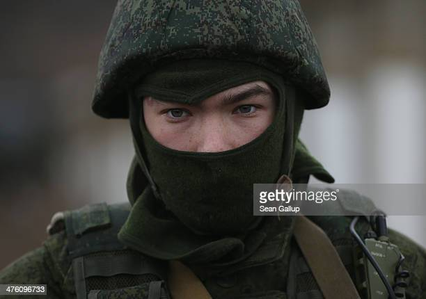 A soldier who was among several hundred that took up positions around a Ukrainian military base stands near the base's periphery in Crimea on March 2...