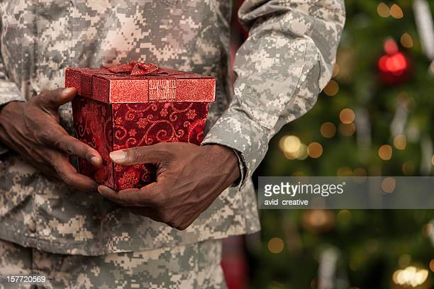 soldier with christmas gift - army christmas stock pictures, royalty-free photos & images