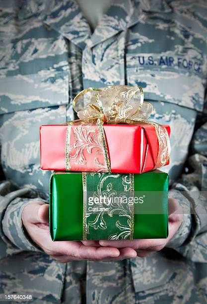 us soldier with christmas gifts - patriotic christmas stock pictures, royalty-free photos & images